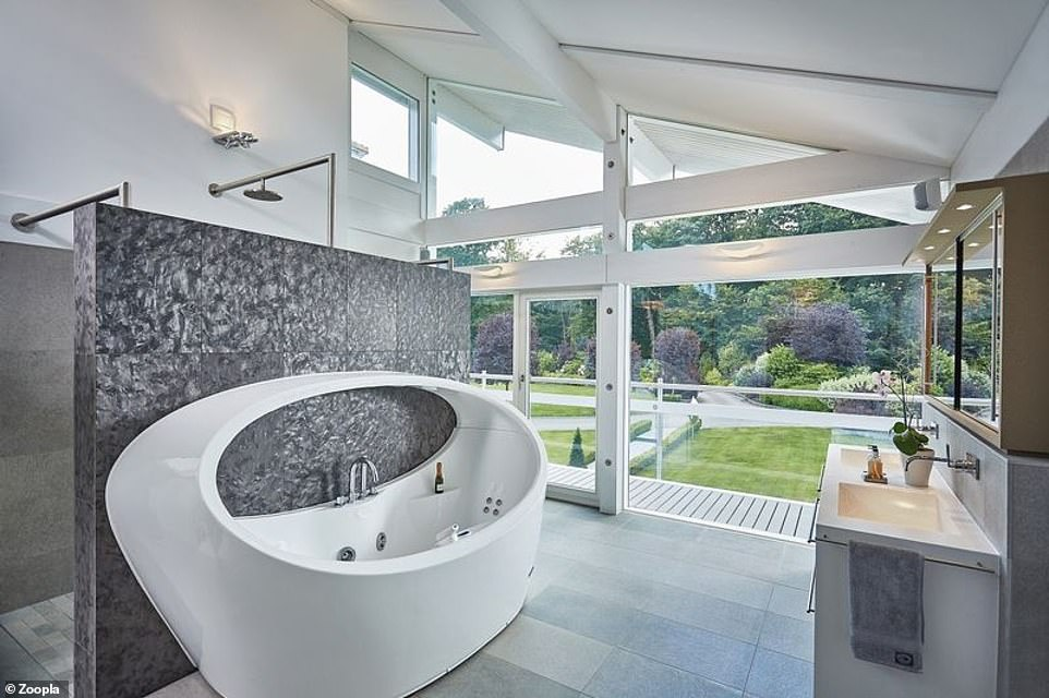 The en-suite bathroom includes a walk-in designer jacuzzi