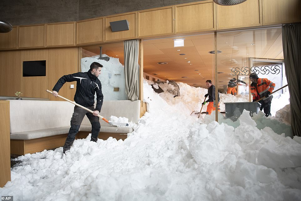 Images show the scale of the avalanche after it cascaded in through the windows of the hotel inSchwaegalp, Switzerland yesterday