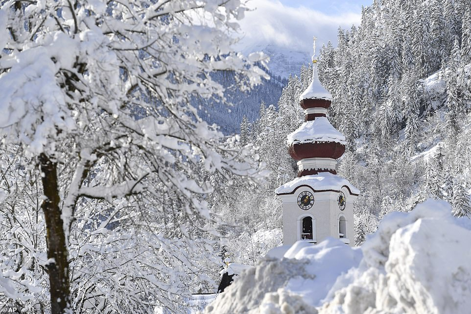 The steeple of the Loferer church is seen through the snow on Friday in theAustrian province of Salzburg