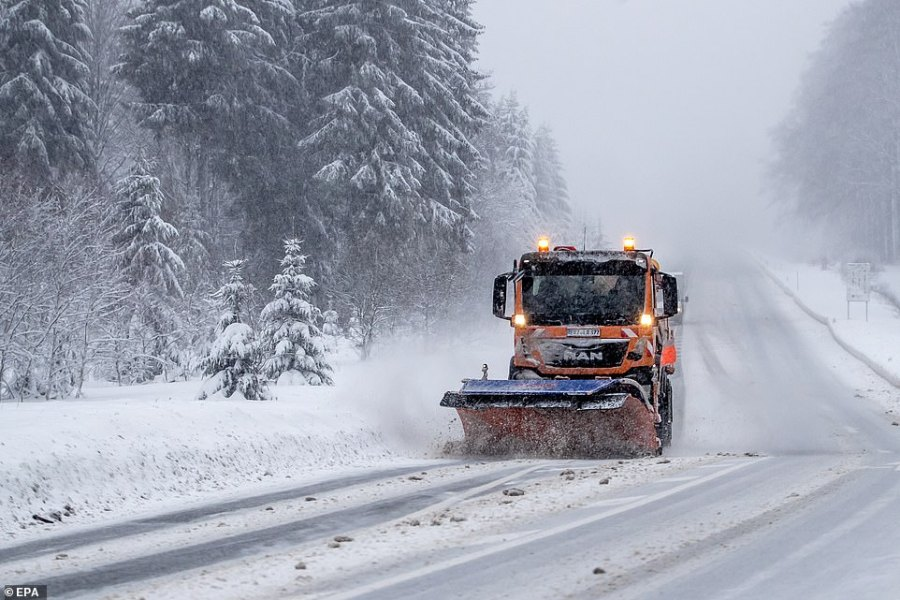 A snowplow driver died Friday in Germany after his vehicle toppled into an icy river, while an electrical worker in Albania suffered a fatal heart attack while repairing damaged power lines. Police in Lenggries, south of Munich, said the 48-year-old snowplow driver was rescued from the river after several hours but died in a hospital (pictured is a snowplow driver in Germany)