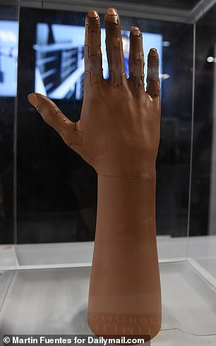 The arm is equipped with muscle sensors and an artificially intelligent control system, which work together to give amputees the ability to grip objects and move their fingers individually
