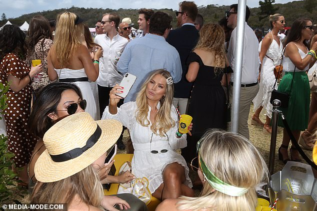 Back to her old tricks! Keira Maguire (M) is caught taking selfies while spending time with boyfriend Jarrod Woodgate at the Portsea Polo… just months after they broke up over her 'Instagram obsession'