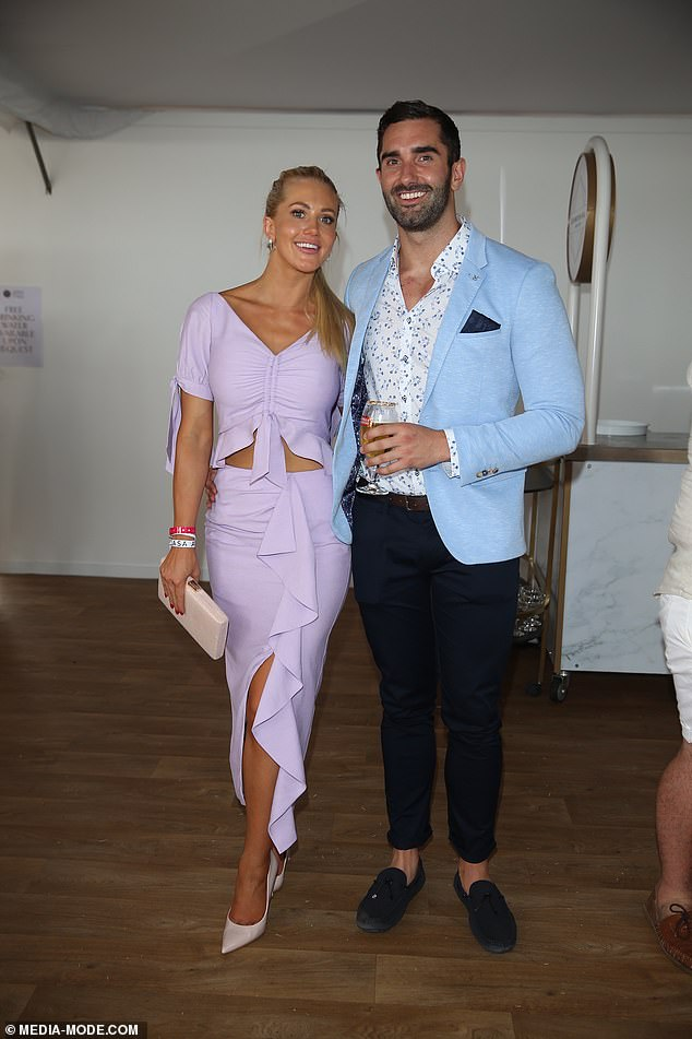 Pretty:The reality TV couple were more subdued inside the event, with Ali showing off the waterfall detailing of her skit and the glimpse of midriff offered by her top