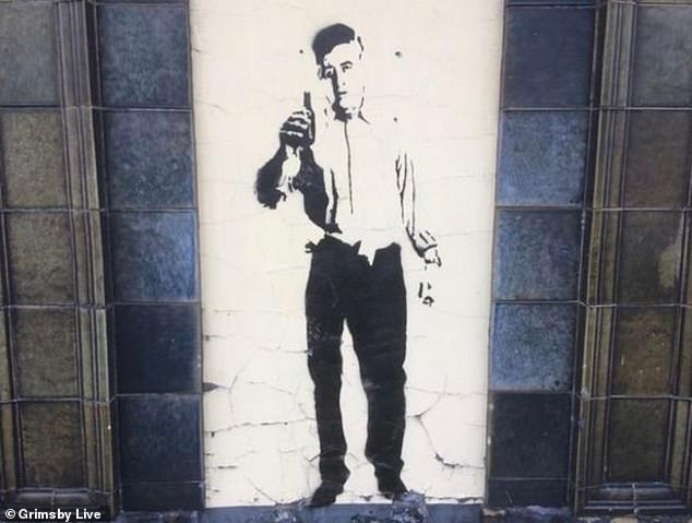 A figure of a man holding a beer bottle has appeared on The Albion pub in Grimsby
