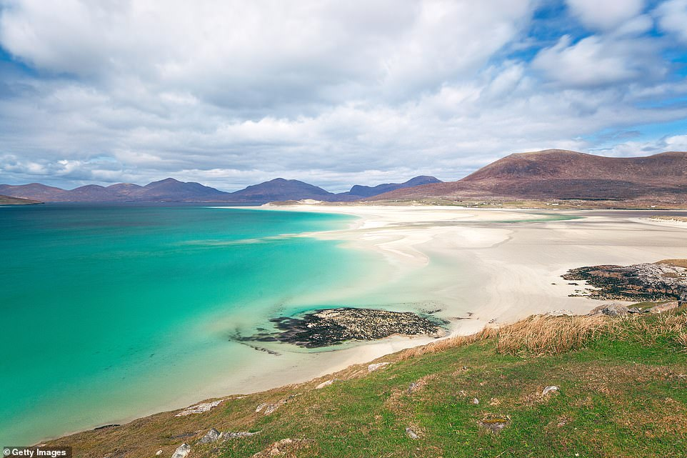 Rounding out the top ten list is the island of Harris in Scotland, pictured. It is known for its sandy beaches such as the beach of Luskentyre, on the photo