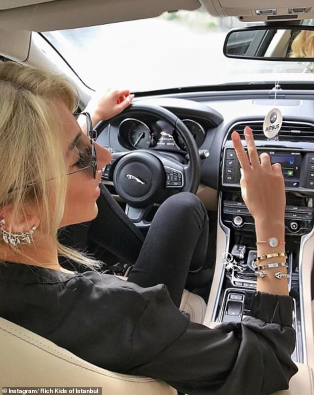 This pilot took her Jaguar out for a spin while dripping with obligatory diamonds of course
