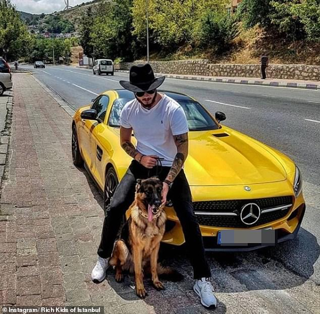 Showcasing both style and sophistication this young man poses with his two greatest loves, his dog and his car