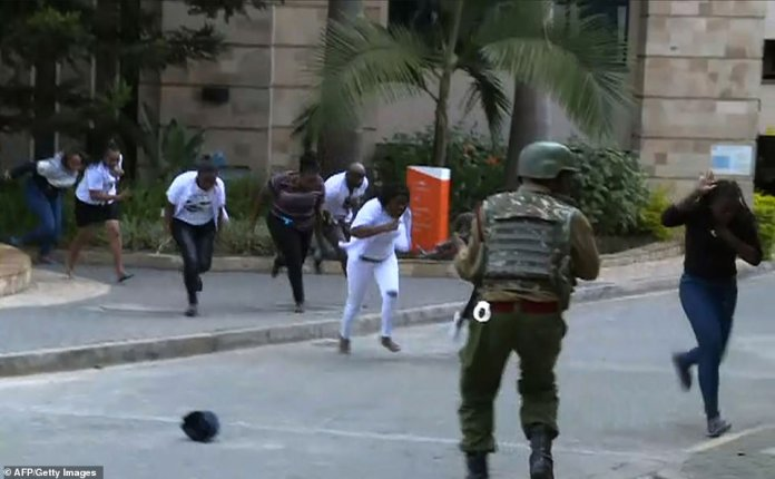 Survivors run for their lives in the street as a gunfight ensued between al Shabaab terrorists and Kenyan security guards