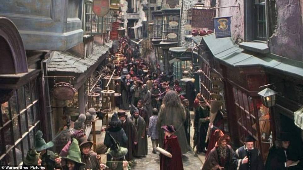Diagon Alley pictured in one of the Harry Potter movies. It is the magical shopping market whereHarry and his friends get their wands and owls