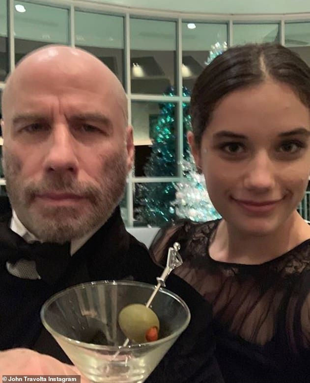 Smooth operator:The Grease star, who has worn a variety of wigs and hairpieces throughout his career, unveiled his new look in a selfie with his 18-year-old daughter