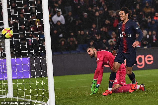Edinson Cavani watches the ball into the back of the net after nodding home for the hosts