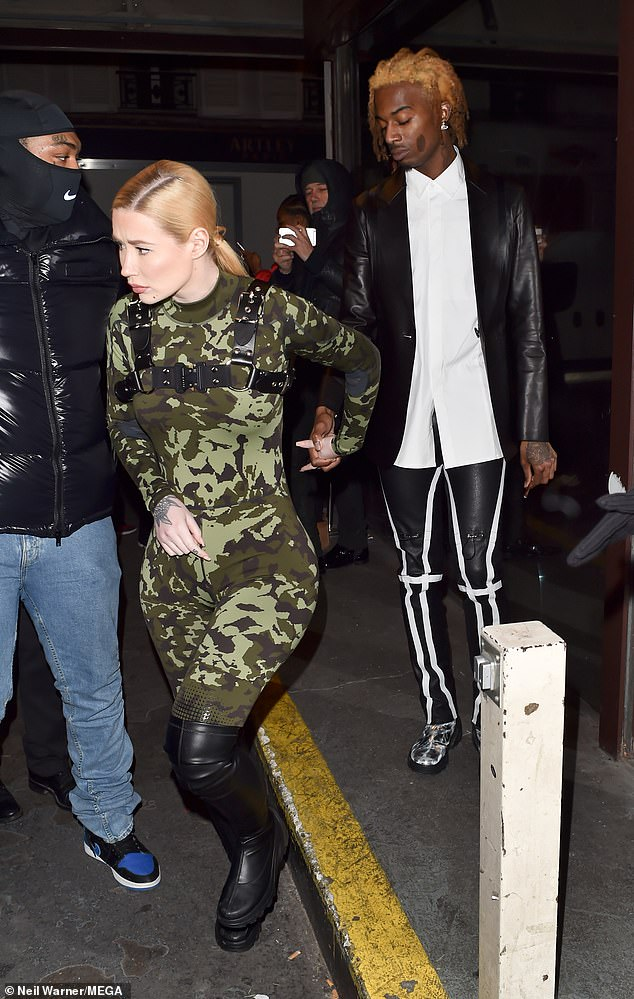 Her man: Iggy's beau, Playboi Carti had been to court, where he was fined $1080 (£800) for punching his tour bus driver, despite pleading not guilty - the pair are now in Paris for Fashion Week