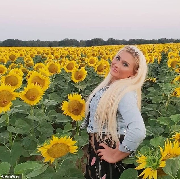 Pictured: Didem Uslu stands in a field of sunflowers with striking blonde hair. Her social media posts show that she performed at dinners and events
