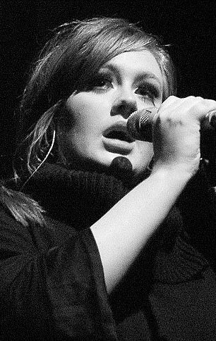 More recent music like Adele's (pictured) contain more lyrics dealing with sadness