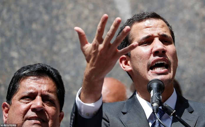 Guaido, pictured, who is head of the National Assembly, proclaimed himself 'acting president' on Wednesday