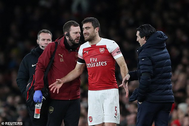 """Arsenal's injury concerns  have grown as Sokratis Papastathopoulos is ruled out for a month  Another Arsenal player is set to be out for weeks """"More bad news for Unai Emery"""" 9055482 6638169 image a 23 1548626790765"""