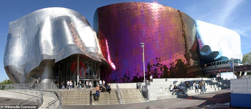 The Museum of Pop Culture in Seattle is most certainly a distinctive building - it's based on the shape of a 'smashed electric guitar'. It was designed by Frank Gehry and looks similar to the well-known Guggenheim Museum in Bilbao. The Seattle Center Monorail, on the right, runs right through the building