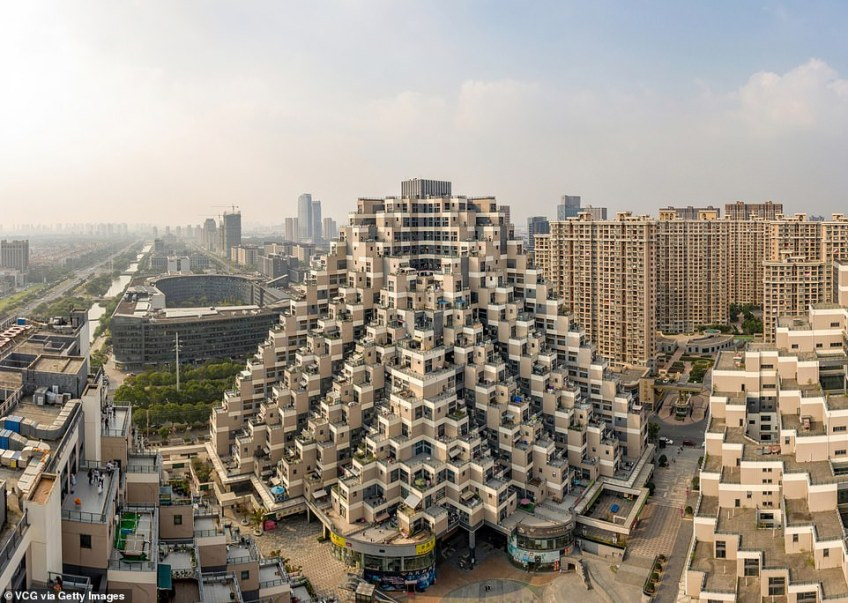 This jaw-droppingly wacky pyramid-shaped building is an 18-storey residential structure situated in Kunshan, a city near Shanghai. It stands at 330 feet tall and was designed by Masters' Architectural Office. The Shanghai-based firm said it was inspired by parkour, an urban activity much-loved by Chinese city dwellers that sees people running and jumping between buildings
