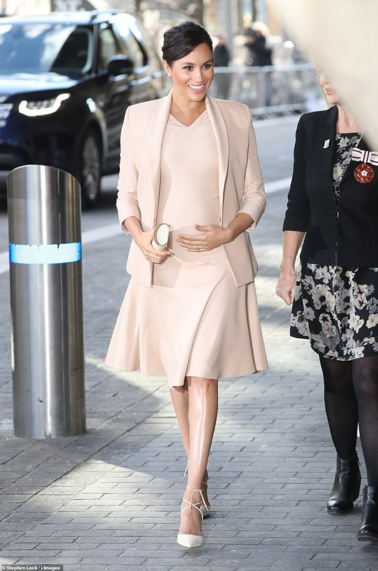 The Duchess of Sussex arrives at the National Theatre on London 's South Bank for her first official visit since succeeding the Queen as its royal patron. Meghan, who is six months pregnant, wore head-to-toe peach
