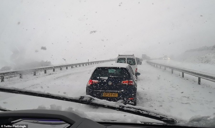 Cars queue in severe weather conditions on Bodmin Moor in Cornwall this afternoon
