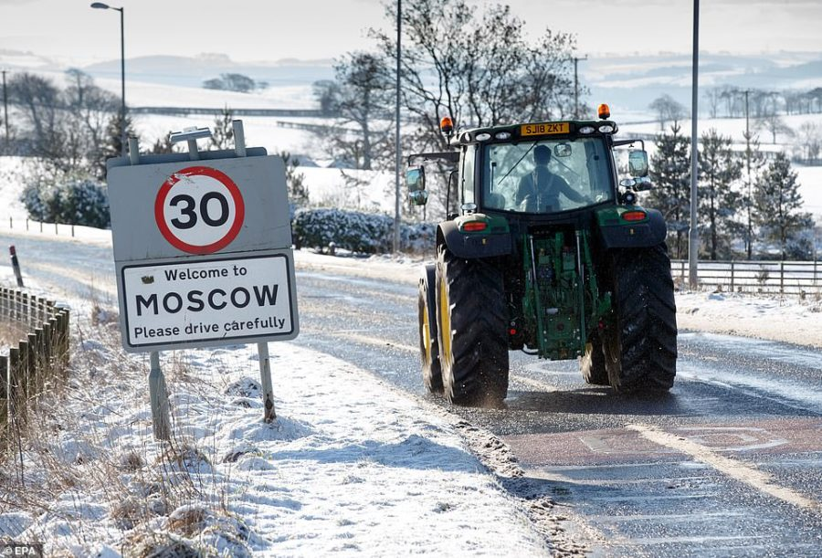 A tractor drives into the village of Moscow in Ayrshire this afternoon - which looks rather like its Russian counterpart