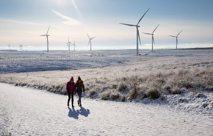 People enjoy a walk through Whitelee Windfarm in North Ayrshire this afternoon amid the low temperatures, ice and snow