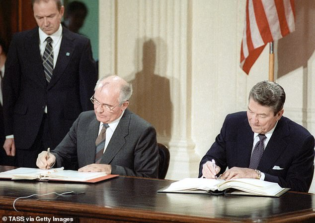 Pioneering moment: The INF was signed in 1987 by Mikhail Gorbachev and Ronald Reagan and banned ground-based cruise missiles with ranges from 315 miles to3,415 miles