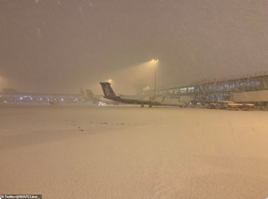 Manchester Airport is blanketed in snow this evening. The Met Office has issued an amber warning for snow that carries a potential risk to life while Transport for London and Network Rail are telling passengers to get home by 9pm