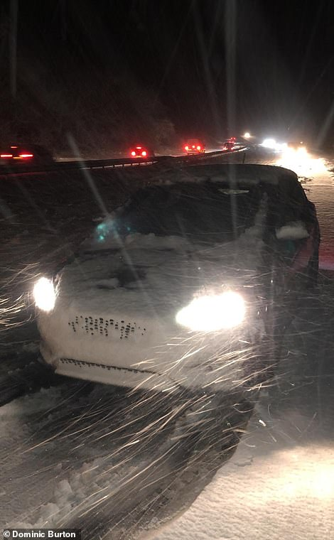 Cars were buried under snow on the A30