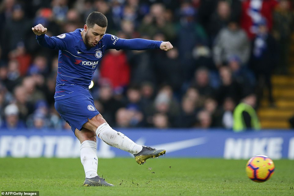 Chelsea's Eden Hazard scores from the penalty spot to take his team 2-0 ahead in the first half against Huddersfield Town