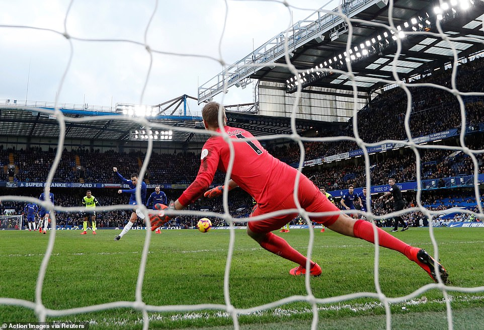 Chelsea's Hazard sends the Huddersfield Town goalkeeper the wrong way as he scores the penalty to make it 2-0
