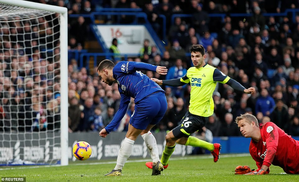 Hazard rounds keeper Jonas Lossl and slots the ball home from a tight angle for his team's third goal