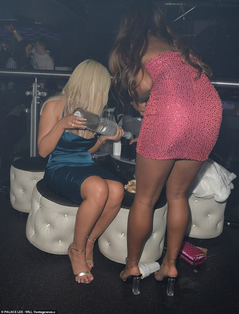 Top it up: The ladies ensured their drinks were topped up, sipping on vodka throughout the evening