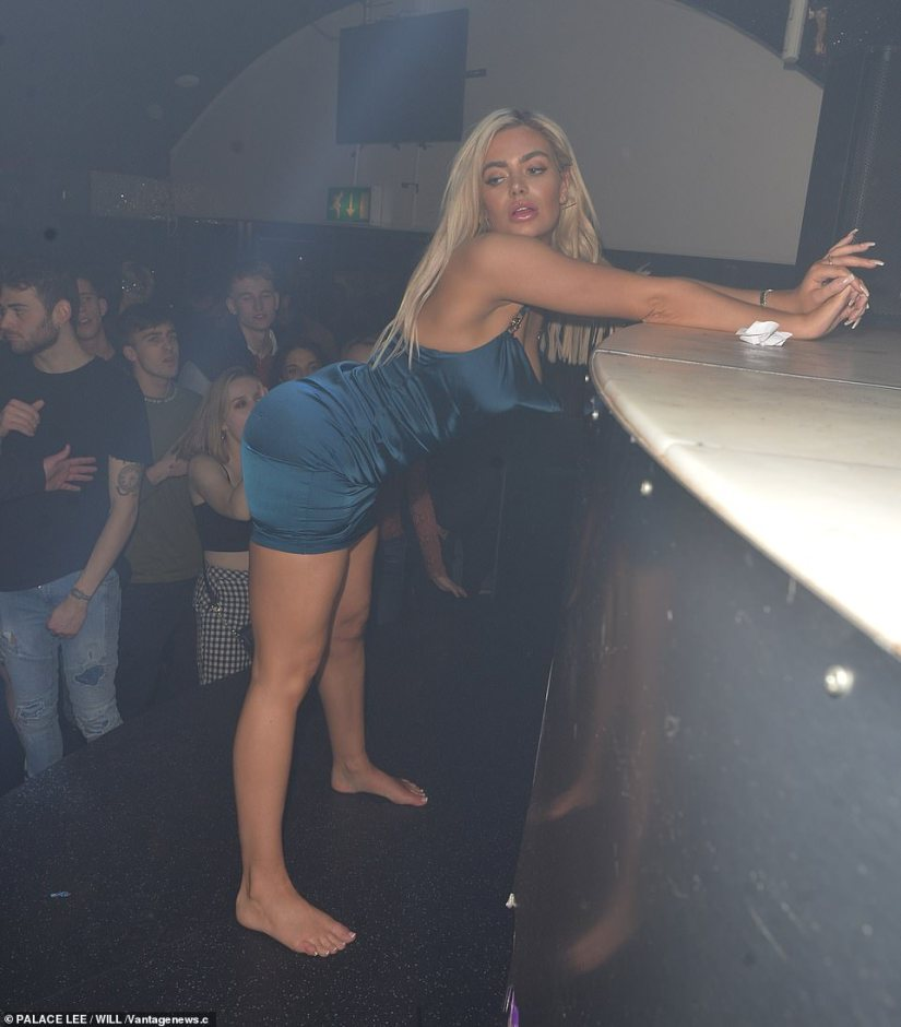 Feeling sexy: Megan clearly wasn't feeling shy as she stood on stage with her feet apart, seductively pushing her derriere towards the audience