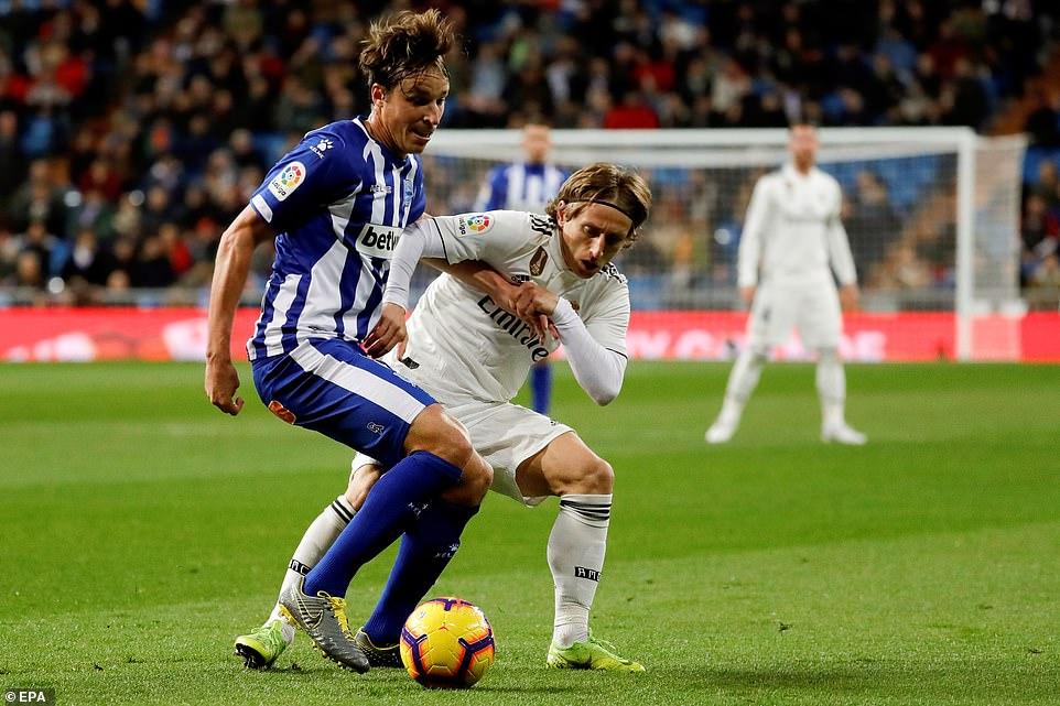 Ballon d'Or winner Luka Modric battles for the ball with Deportivo Alaves' Tomas Pina