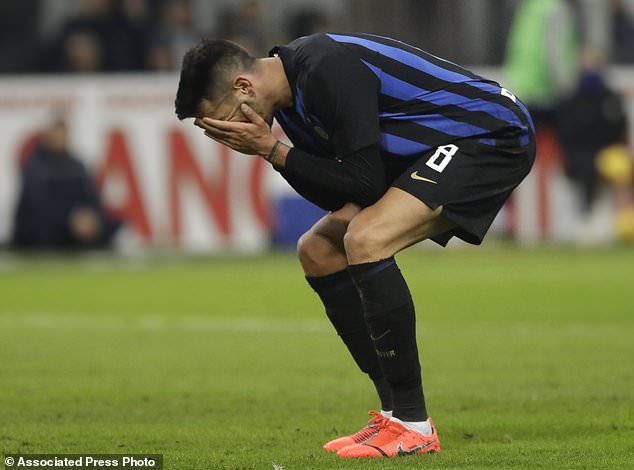 Inter Milan's Matias Vecino reacts after missing a chance during the Serie A soccer match between Inter Milan and Bologna, at the San Siro stadium in Milan, Italy, Sunday, Feb. 3, 2019. (AP Photo/Luca Bruno)