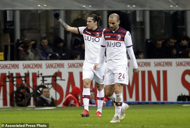 Bologna's Federico Santander, left, celebrates with teammate Rodrigo Palacio after scoring his side's opening goal during the Serie A soccer match between Inter Milan and Bologna, at the San Siro stadium in Milan, Italy, Sunday, Feb. 3, 2019. (AP Photo/Luca Bruno)