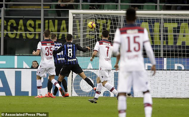 Bologna's Federico Santander scores his side's opening goal during the Serie A soccer match between Inter Milan and Bologna, at the San Siro stadium in Milan, Italy, Sunday, Feb. 3, 2019. (AP Photo/Luca Bruno)