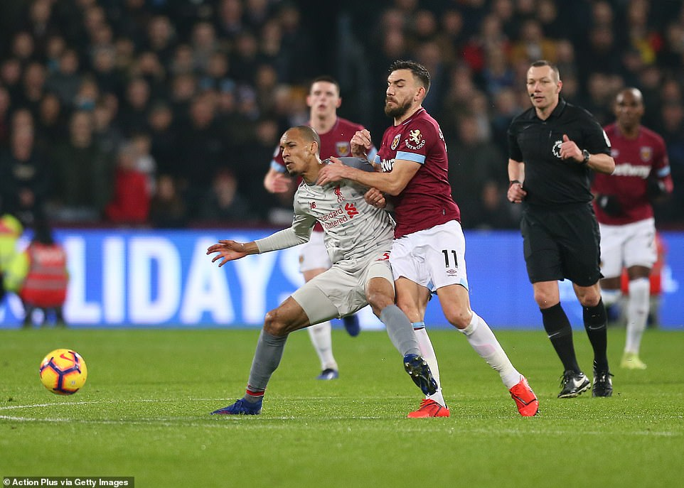 It was a scrappy affair in midfield as the two sides tried to control the game - Fabinho and Robert Snodgrass often tussled