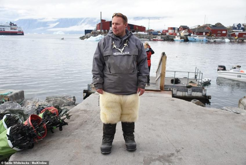 Decked out in polar bear fur trousers and wearing animal claws on a string around his neck, Marti Suulutsun certainly makes for an impressive sight. The 35-year-old lives on the remote island of Uummannaq in Greenland