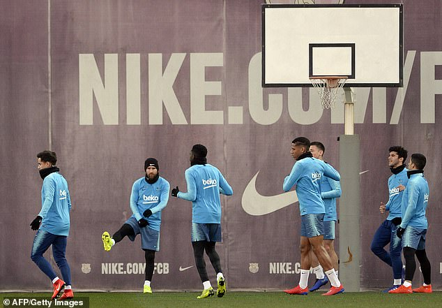 With a basketball hoop close by, Messi did some pre-session stretches with his team-mates