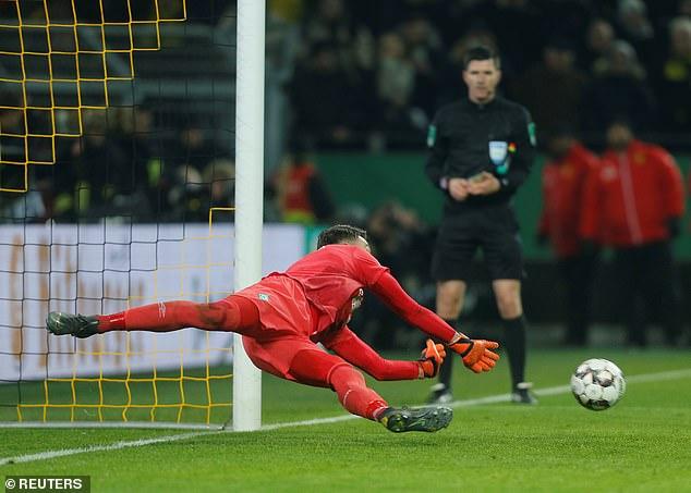 Jiri Pavlenka saves a low penalty in Werder Bremen's shootout win over Borussia Dortmund