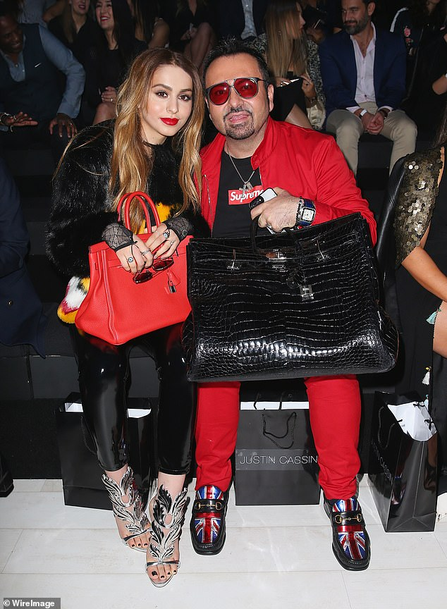 Napoleon Perdis (pictured with his daughter Liana in the front row at the Australian Fashion Show in 2017) has fired back at critics for slamming his 'lavish' lifestyle just days after his $125million beauty empire collapsed into voluntary administration