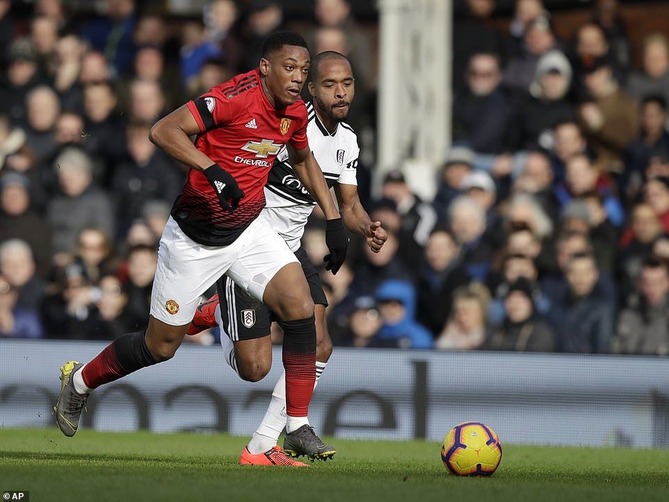 Martial's pace and trickery proved too much for Fulham right back Denis Odoi (right) who was left trailing in his wake