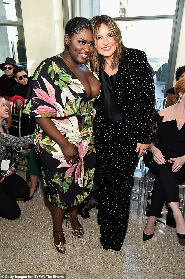Stars of the small screen: The Netflix star, who has also acted on Broadway, slipped into a pair of heels that matched her dress and smiled for the shutterbugs with Mariska Hargitay
