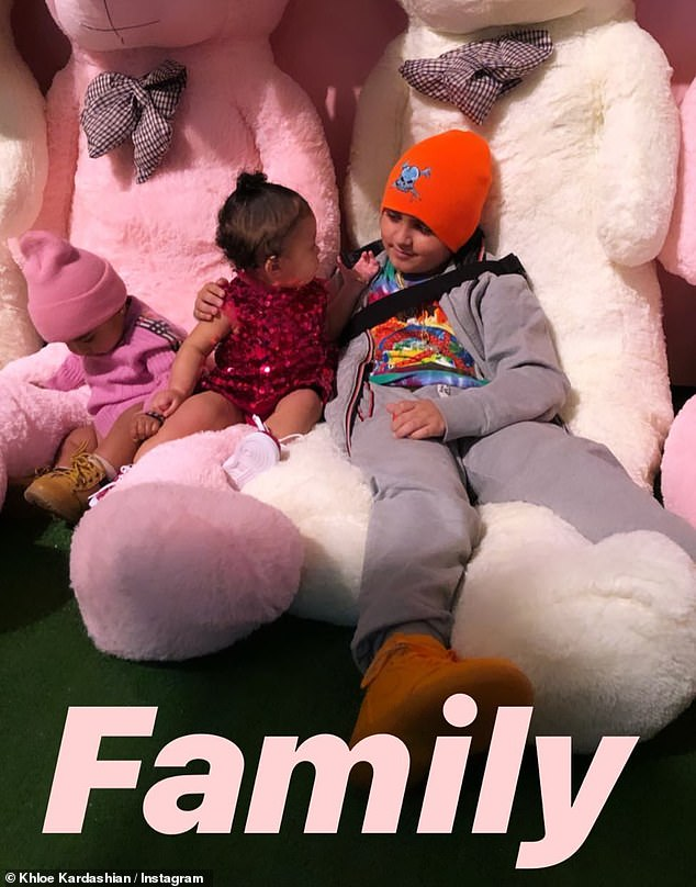 """""""Family"""": the real poses with his cousins Stormi Webster [center] and Mason Disick"""