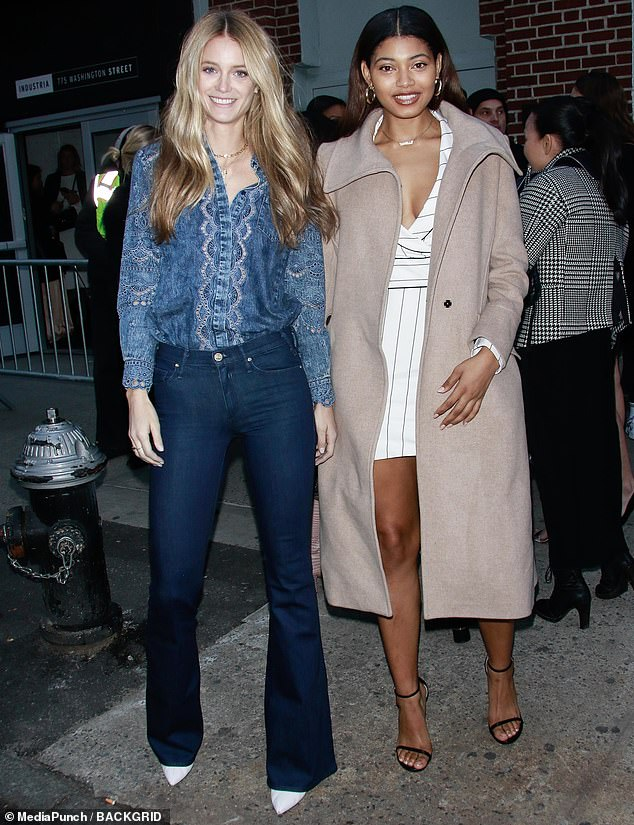 Youthful looks: Kate Bock, 26, tucked in a bohemian-inspired blouse into a pair of bell bottom jeans, while Danielle Herrington, 25, attempted to keep warm by layering an oatmeal coat over a striped mini dress