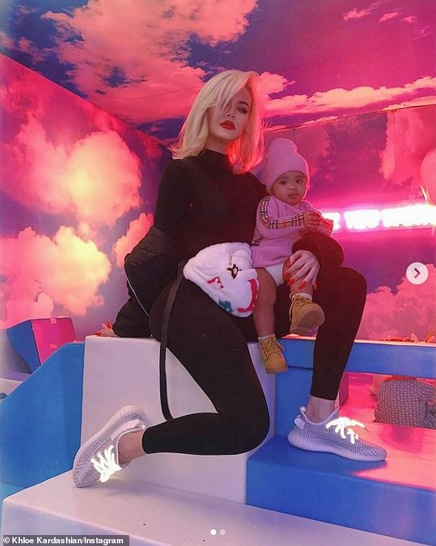 Cute in pink! Khloe Kardashian has released some lovely photos of herself with her nine-month-old daughter True during the lavish party for Kylie Jenner's daughter, Stormi Webster