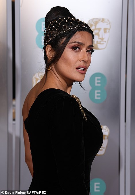 Gorgeous: The brunette beauty scraped her hair into a high bun with tendrils loosely framing her face, which was perfectly made up to enhance her good looks