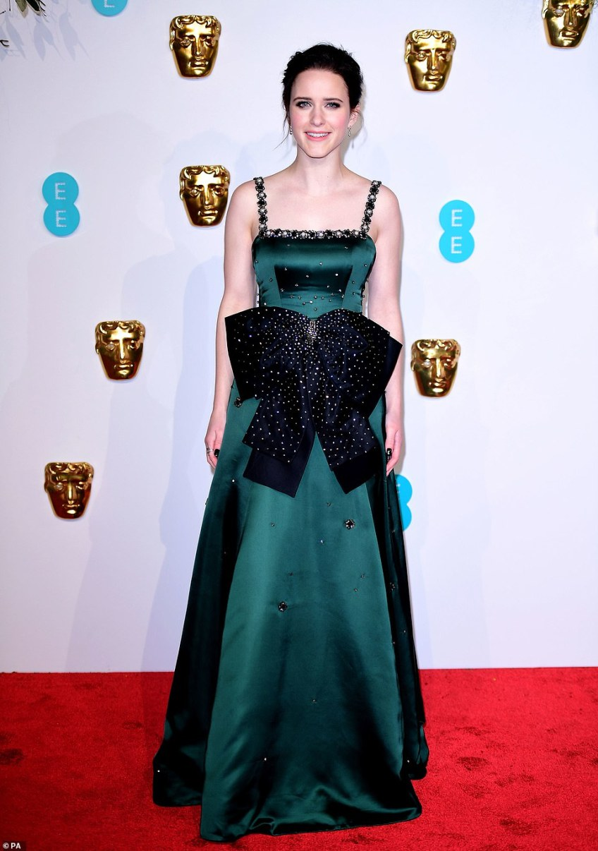 Stunning: Rachel Brosnahan dazzled in a deep green number with silver embellished detailing and an extravagant bow